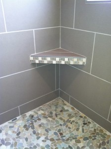 pebble-tile-shower-floor-with-shelf-and-large-format-tiles