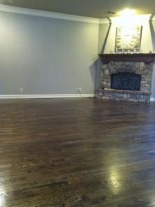stone-fireplace overlooking-beautiful-hand-scraped-solid-hardwood-floor