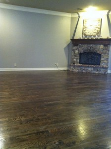 stone-fireplace overlooking-beautiful-hand-scraped-solid-hardwood-floor
